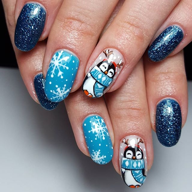 Blue Christmas nails and snowflakes
